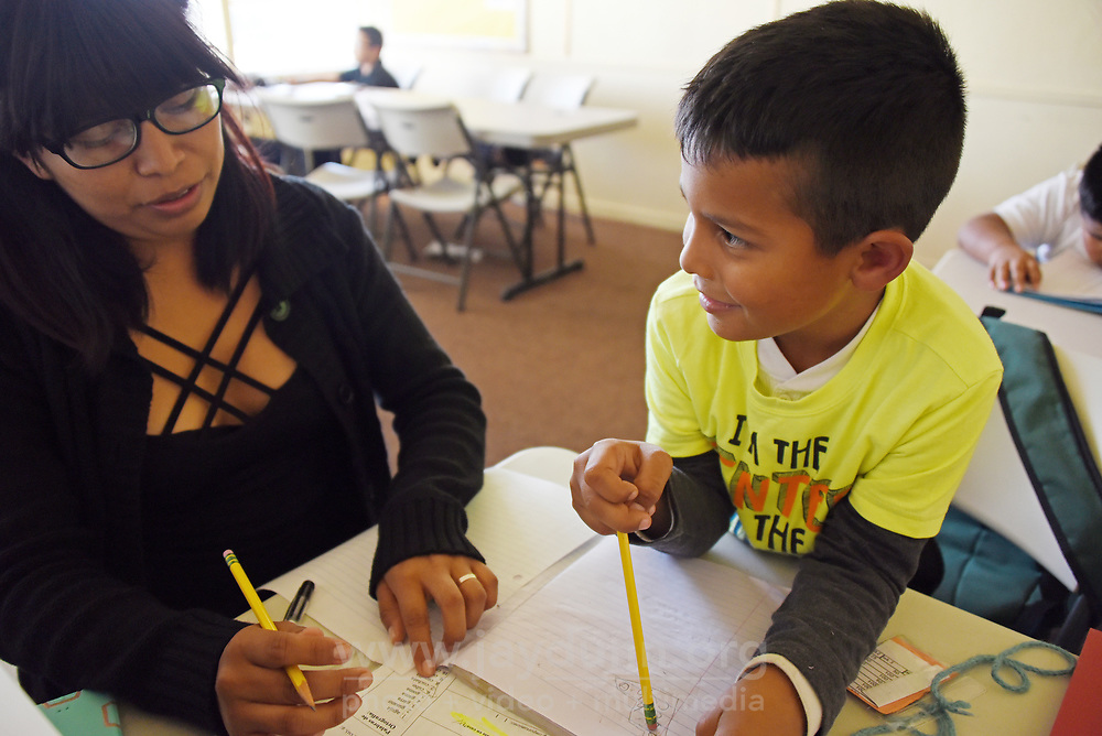 At the East Salinas Family Center, where the LIFE program is housed, tutor Paola Chepe helps six-year-old Cristofer Zarate with his Spanish vocabulary.