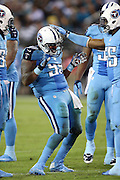 Tennessee Titans defensive end Jurrell Casey (99) gets a pat on the helmet from Tennessee Titans inside linebacker Zach Brown (55) as Casey celebrates after a fourth quarter sack during the 2015 week 11 regular season NFL football game against the Jacksonville Jaguars on Thursday, Nov. 19, 2015 in Jacksonville, Fla. The Jaguars won the game 19-13. (©Paul Anthony Spinelli)