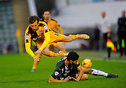 Plymouth Argyle's Kelvin Mellor tackles Cambridge Utd's Harrison Dunk during the Sky Bet League 2 match between Plymouth Argyle and Cambridge United at Home Park, Plymouth, England on 12 December 2015. Photo by Graham Hunt.