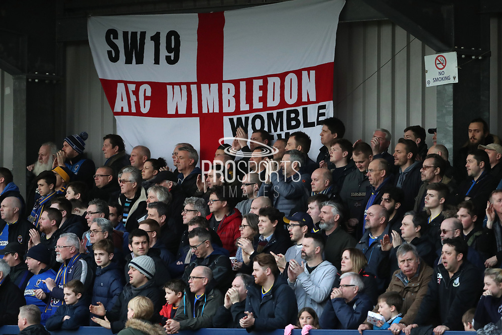 AFC Wimbledon fans celebrating win during the EFL Sky Bet League 1 match between AFC Wimbledon and Oxford United at the Cherry Red Records Stadium, Kingston, England on 10 March 2018. Picture by Matthew Redman.