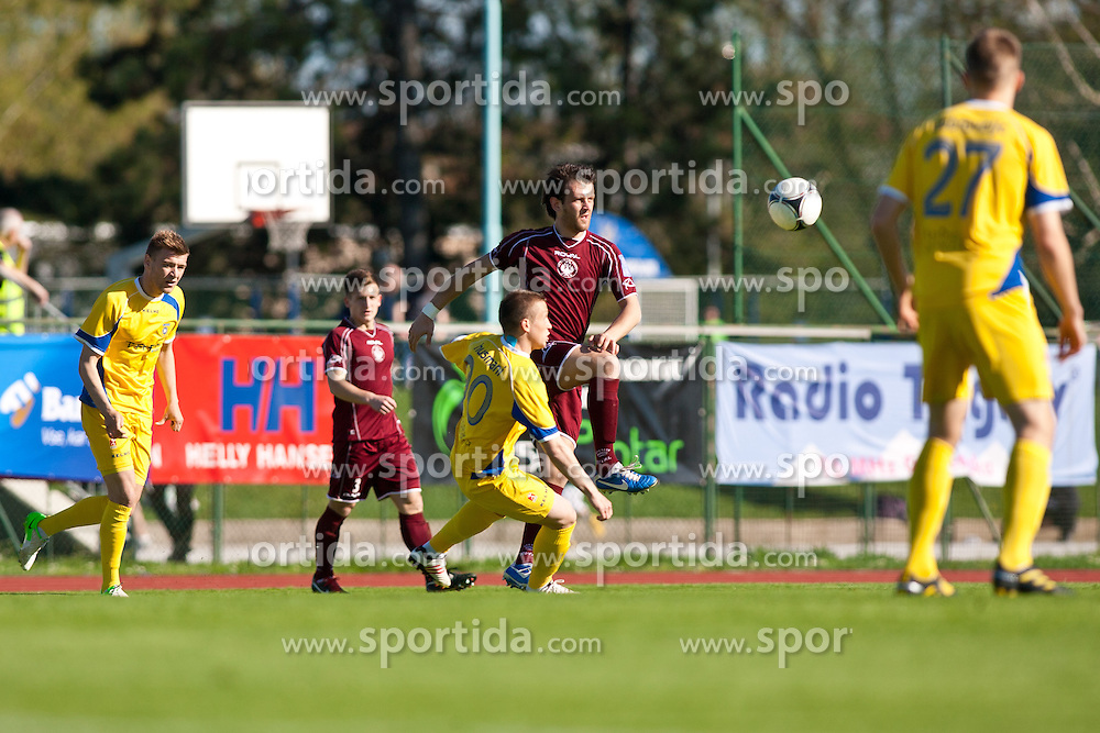 Tilen Klemencic of NK Triglav and Zeni Husmani of NK Domzale during football match between NK Triglav and NK Domzale in 23th Round of Slovenian First League PrvaLiga NZS 2012/13 on April 24, 2013 in Sports park Kranj, Slovenia. (Photo by Grega Valancic / Sportida)