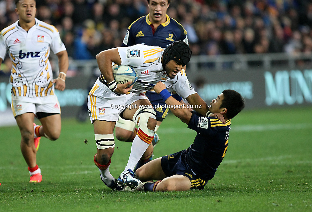 Tevita Koloamatangi of the Chiefs, left, in the tackle of Highlanders Fumiaki Tanaka in the Super 15 rugby match, Highlanders v Chiefs, Forsyth Barr Stadium, Dunedin, New Zealand, Friday, June 27, 2014. Photo: Dianne Manson / www.photosport.co.nz