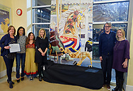 Garden City, New York, USA. March 9, 2019. L-R. New York State Assemblywoman JUDY GRIFFIN (District 21), VANESSA LOCKEL (LIRR Community Affairs Rep) Hempstead Town Supervisor LAURA GILLEN, mural artist MICHAEL WHITE, Nassau County Legislator DEBRA MULÉ (L.D. 5) pose next to mural during Unveiling Ceremony. Event was held at historic Nunley's Carousel in its Pavilion on Museum Row on Long Island.