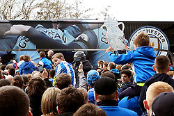 A young Huddersfield Town fan holds up a home made FA Cup as the Manchester City team coach pulls up at the stadium - Mandatory by-line: Matt McNulty/JMP - 18/02/2017 - FOOTBALL - The John Smith's Stadium - Huddersfield, England - Huddersfield Town v Manchester City - Emirates FA Cup fifth round