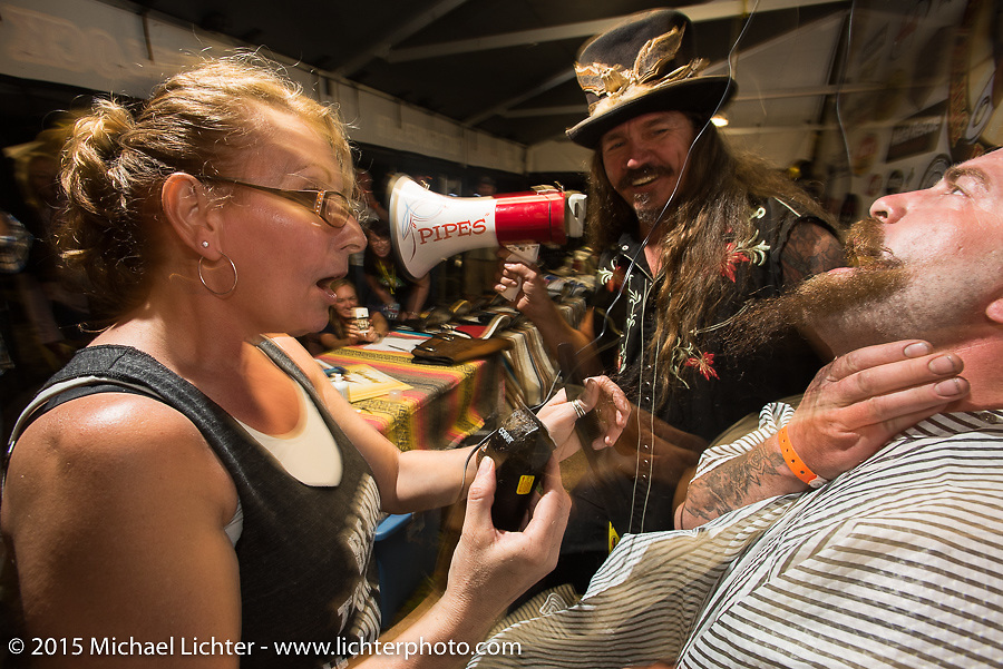 """Bean're MC's the Chop-In Blocks """"Biker Beard-Off"""" to benefit the Aidan Jack Seeger foundation for ALD at the Cackleberry Campground during Daytona Beach Bike Week, FL, USA. Thursday, March 12, 2015.  Photography ©2015 Michael Lichter."""