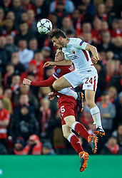 LIVERPOOL, ENGLAND - Tuesday, April 24, 2018: Liverpool's Andy Robertson and AS Roma's Alessandro Florenzi during the UEFA Champions League Semi-Final 1st Leg match between Liverpool FC and AS Roma at Anfield. (Pic by David Rawcliffe/Propaganda)