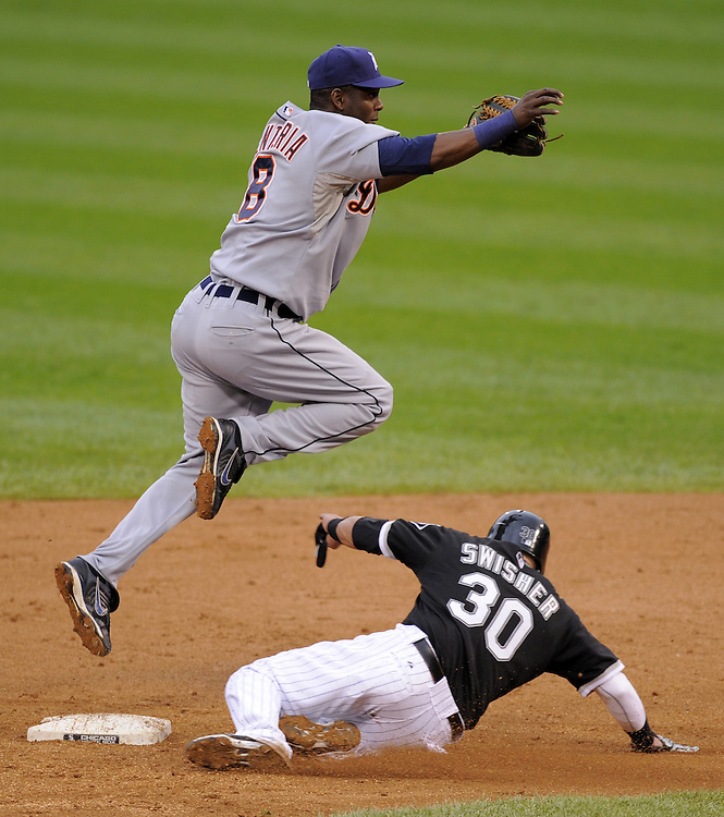 CHICAGO - SEPTEMBER 14:  Edgar Renteria #8 of the Detroit Tigers turns a double play over a sliding Nick Swisher #30 during the first game of a double header against the Chicago White Sox at U.S. Cellular Field in Chicago, Illinois on September 14, 2008.  The White Sox defeated the Tigers in Game One 4-2.  (Photo by Ron Vesely)