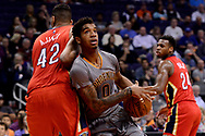 Feb 13, 2017; Phoenix, AZ, USA; Phoenix Suns forward Marquese Chriss (0) drives the ball against New Orleans Pelicans center Alexis Ajinca (42) in the first half of the NBA game at Talking Stick Resort Arena. Mandatory Credit: Jennifer Stewart-USA TODAY Sports