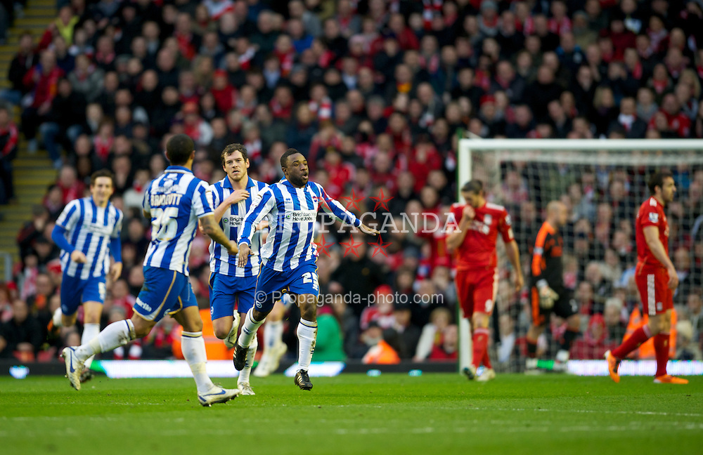 LIVERPOOL, ENGLAND - Saturday, February 19, 2012: Brighton & Hove Albion's Kazenga LuaLua celebrates scoring his side's first goal against Liverpool during the FA Cup 5th Round match at Anfield. (Pic by David Rawcliffe/Propaganda)