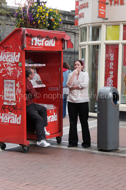 Newspaper stand on Grafton Street in Dublin Ireland. The Evening Herald is a tabloid evening newspaper published by Independent News and Media.