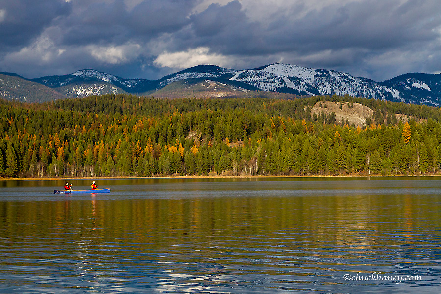 Canoeing in autumn on Beaver Lake near Whitefish, Montana, USA model released