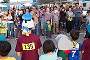 Parents cheer for their children during a costume contest at the Run for Fun fundraiser at Zanker Elementary School in Milpitas, California, on April 30, 2016. (Stan Olszewski/SOSKIphoto)