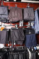 Variety of formal pants hanging on hanger at store