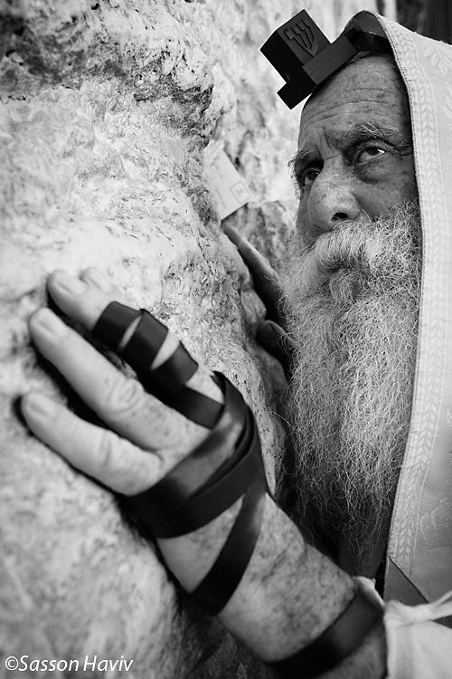 An elderly orthodox Jewish Man praying at the Wailing wall, Jerusalem, Israel.