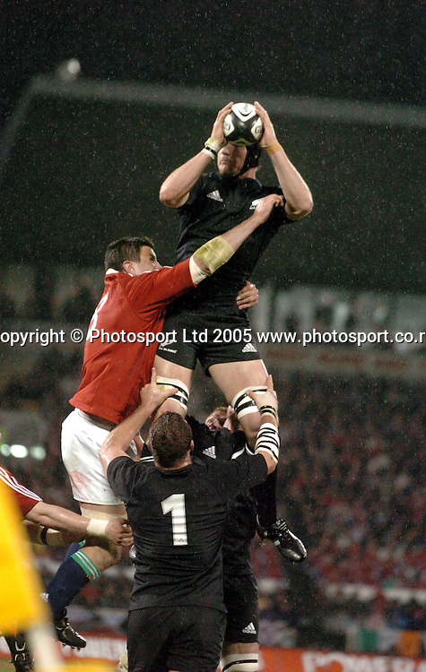 All Black lock Ali Williams takes in the lineout ball during the first test between the All Blacks and the British and Irish Lions at Jade Stadium, Christchurch, New Zealand, on Saturday 25 June, 2005. The All Blacks won the match 21-3. Photo: Fotosport/PHOTOSPORT. **NZ USE ONLY**<br />