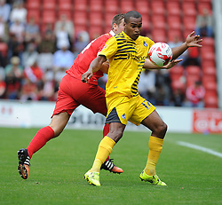 Jermaine Easter of Bristol Rovers is challenged by Connor Essam of Leyton Orient - Mandatory byline: Neil Brookman/JMP - 07966386802 - 29/08/2015 - FOOTBALL - Matchroom Stadium -Leyton,England - Leyton Orient v Bristol Rovers - Sky Bet League Two
