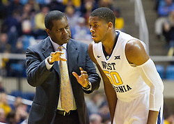Nov 20, 2016; Morgantown, WV, USA; West Virginia Mountaineers associate head coach Larry Harrison speaks with West Virginia Mountaineers forward Sagaba Konate (50) during the second half against the New Hampshire Wildcats at WVU Coliseum. Mandatory Credit: Ben Queen-USA TODAY Sports