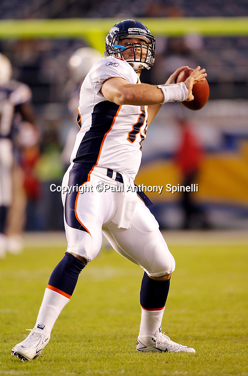 Denver Broncos quarterback Tim Tebow (15) throws a pregame pass during the NFL week 11 football game against the San Diego Chargers on Monday, November 22, 2010 in San Diego, California. The Chargers won the game 35-14. (©Paul Anthony Spinelli)