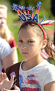 IVYLAND, PA - MAY 26:  Brownie Troop 2849 member Hailey Rodriguez, 9, of Warminster, Pennsylvania applauds during the Ivyland Memorial Day Parade and Ceremony May 26, 2014 in Ivyland, Pennsylvania. (Photo by William Thomas Cain/Cain Images)