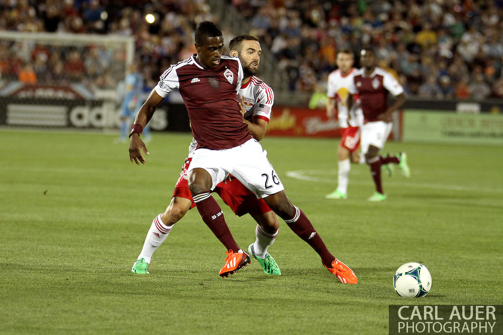 July 4th, 2013 - Colorado Rapids forward Deshorn Brown (26) attempts to keep the ball away from New York Red Bulls midfielder Brandon Barklage (25) in the second half of action in the Major League Soccer match between New York Red Bulls and the Colorado Rapids at Dick's Sporting Goods Park in Commerce City, CO