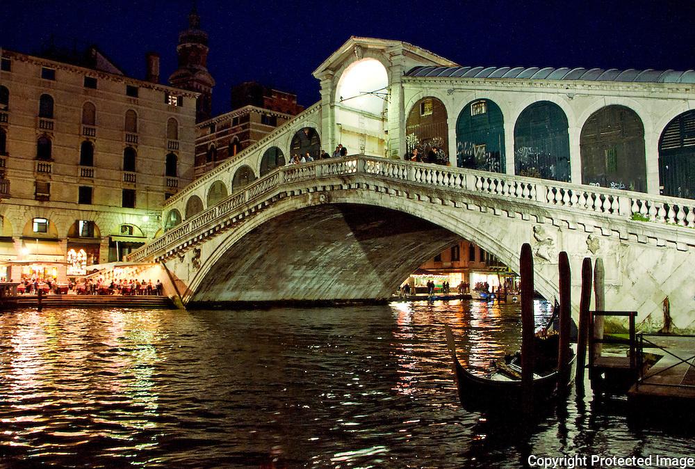 The imposing Rialto Bridge on the Grand Canyon at night in Venice, Italy.