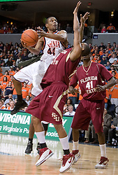 Virginia Cavaliers point guard Sean Singletary (44) shoots over Florida State Seminoles guard Jerel Allen (11).  The Virginia Cavaliers Men's Basketball Team defeated the Florida State Seminoles 73-70 at the John Paul Jones Arena in Charlottesville, VA on February 17, 2007.