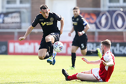 Gary Roberts of Wigan Athletic goes past Ashley Eastham of Fleetwood Town - Mandatory by-line: Robbie Stephenson/JMP - 21/04/2018 - FOOTBALL - Highbury Stadium - Fleetwood, England - Fleetwood Town v Wigan Athletic - Sky Bet League One