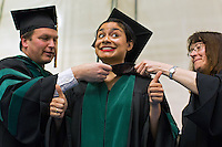 05/17/2015 - Medford/Somerville, MA - Dr. Gillian Morris receives her hood at Tufts University School of Medicine and Sackler School of Graduate Biomedical Sciences's Phase II ceremony in Gantcher Center during Tufts University's 159th Commencement on Sunday, May 17, 2015.(Matthew Healey/Tufts University)