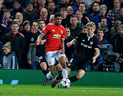 MANCHESTER, ENGLAND - Tuesday, March 13, 2018: Manchester United's Marcus Rashford and Sevilla's Éver Banega and Simon Kjaer during the UEFA Champions League Round of 16 2nd leg match between Manchester United FC and Sevilla FC at Old Trafford. (Pic by David Rawcliffe/Propaganda)