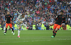 April 29, 2017 - Madrid, Spain - MADRID, SPAIN. APRIL 29th, 2017 - Luca Modric shoots on goal. La Liga Santander matchday 35 game. Real Madrid defeated 2-1 Valencia with goals scored by Cristiano Ronaldo (26th minute) and Marcelo (86th minute). Parejo (82nd minute) scored for Valencia. Santiago Bernabeu Stadium. Photo by Antonio Pozo | PHOTO MEDIA EXPRESS (Credit Image: © Antonio Pozo/VW Pics via ZUMA Wire/ZUMAPRESS.com)