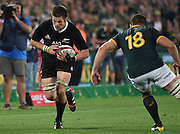 JOHANNESBURG, South Africa, 04 October 2014 : Richie McCaw (C) of the All Blacks tries to beat Marcel van der Merwe of the Springboks during the Castle Lager Rugby Championship test match between SOUTH AFRICA and NEW ZEALAND at ELLIS PARK in Johannesburg, South Africa on 04 October 2014. <br /> The Springboks won 27-25 but the All Blacks successfully defended the 2014 Championship trophy.<br /> <br /> © Anton de Villiers / SASPA