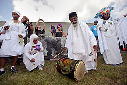 29 August 2015. Lower 9th Ward, New Orleans, Louisiana.<br /> Hurricane Katrina 10th anniversary.<br /> Andrew Wiseman on drums gathers with mourners to remember those who perished during the storm. The ceremony is conducted close to where a barge broke through the levee a decade earlier causing widespread flooding and loss of life. <br /> Photo credit©; Charlie Varley/varleypix.com.