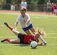 Interlakes' Margaux Dickinson and Laconia's Lyndsey Paronto get tripped up going after the ball during NHIAA Division III Soccer on Friday afternoon.  (Karen Bobotas/for the Laconia Daily Sun)