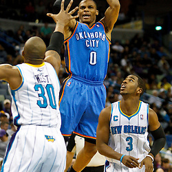 January 24,  2011; New Orleans, LA, USA; Oklahoma City Thunder point guard Russell Westbrook (0) shoots over New Orleans Hornets power forward David West (30) and point guard Chris Paul (3) during the third quarter at the New Orleans Arena. The Hornets defeated the Thunder 91-89. Mandatory Credit: Derick E. Hingle