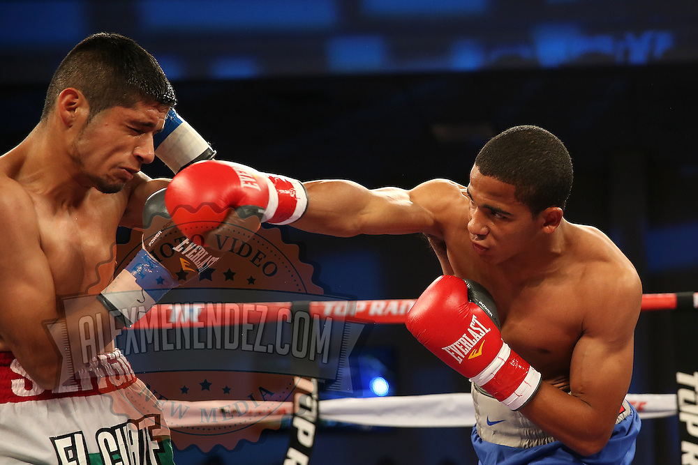 ORLANDO, FL - OCTOBER 04:  Felix Verdejo of Puerto Rico (R) punches Sergio Villanueva of Mexico during their professional lightweight boxing match at the Bahía Shriners Auditorium & Events Center on October 4, 2014 in Orlando, Florida. (Photo by Alex Menendez/Getty Images) *** Local Caption *** Felix Verdejo; Sergio Villanueva