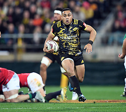 """Ngani Laumape of the Hurricanes breaks out against the Lions in the International rugby match between the the Super Rugby Hurricanes and British and Irish Lions at Westpac Stadium, Wellington, New Zealand, Tuesday, June 27, 2017. Credit:SNPA / Ross Setford  **NO ARCHIVING"""""""