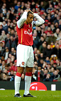 Photo: Ed Godden/Sportsbeat Images.<br /> Arsenal v Wigan Athletic. The Barclays Premiership. 11/02/2007. Arsenal Captain, Thierry Henry, holds his head in his hands after missing a shot.