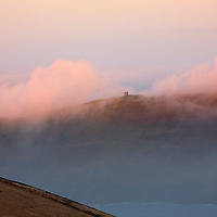 Misty Sunrise at Valentia Island with view on historical bray head tower, Ring of Kerry, County Kerry, Ireland /vl127