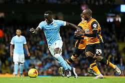 Bacary Sagna of Manchester City and Sone Aluko of Hull City  - Mandatory byline: Matt McNulty/JMP - 01/12/2015 - Football - Etihad Stadium - Manchester, England - Manchester City v Hull City - Capital One Cup - Quarter-final