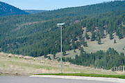 The rolling hills that surround the Grant Creek neighborhood of Missoula, Montana on May 2, 2014, and the intersection of the streets where Diren Dede, a German exchange student lived with his host family and was shot and killed in the garage of Markus Kaarma on April 27, 2014.