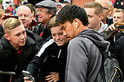Shinji Okazaki (20) of Leicester City has a selfie with a young fans as he gets off the team bus on arrival for the Premier League match between Bournemouth and Leicester City at the Vitality Stadium, Bournemouth, England on 30 September 2017. Photo by Graham Hunt.