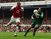 Picture: Henry Browne, Digitalsport<br /> NORWAY ONLY<br /> <br /> Date: 01/05/2004.<br /> Arsenal v Birmingham City FA Barclaycard Premiership.<br /> <br /> City's Ian Bennett manages to keep Arsenal's Thierry Henry at bay.