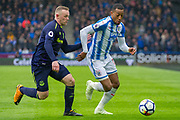 Huddersfield Town Midfielder Rajiv van La Parra holds back Everton forward Wayne Rooney during the Premier League match between Huddersfield Town and Everton at the John Smiths Stadium, Huddersfield, England on 28 April 2018. Picture by Craig Zadoroznyj.