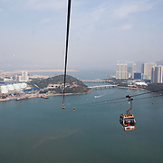 Cable cars take tourists from Tung Chung up the mountains on Lantau to the Ngong Ping, the village with the Giant Buddha. 7 million people live on 1,104km square, making it Hong Kong the most vertical city in the world.