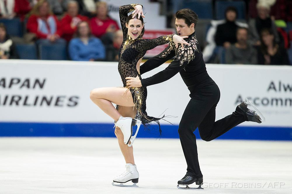 Tessa Virtue and Scott Moir of Canada skate their short program at the 2017 Skate Canada International ISU Grand Prix event in Regina, Saskatchewan, October 27, 2017.<br /> AFP PHOTO/Geoff Robins