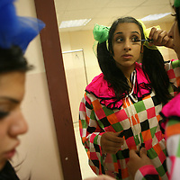 "Members of The Palestinian Circus School put on their make up before going on stage, as they prepare to perform the show ""Circus behind the wall"" in Ramallah, November 20, 2009.The circus group was established in 2006, in order to give a new way of expression for Palestinians, and a new way to deliver the idea of resistance to the occupation. This performance is based on the life of Palestinians behind the separation wall. Photo by Michal Fattal/backyard"