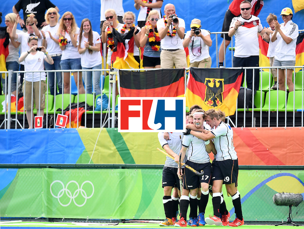 Germany's Christopher Ruhr(2R) celebrates scoring a goal with teammates during the men's field hockey Germany vs India match of the Rio 2016 Olympics Games at the Olympic Hockey Centre in Rio de Janeiro on August, 8 2016. / AFP / MANAN VATSYAYANA        (Photo credit should read MANAN VATSYAYANA/AFP/Getty Images)