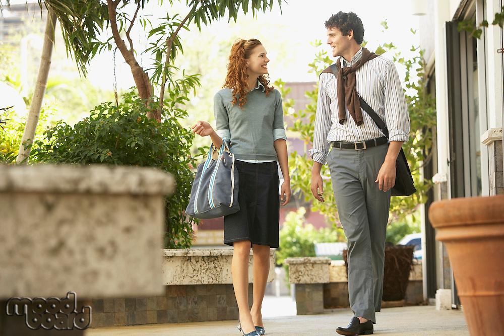 Young couple walking in courtyard