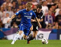 Photo: Daniel Hambury.<br />Chelsea v Anderlecht. UEFA Champions League.<br />13/09/2005.<br />Chelsea's Damien Duff and Anderlecht's Michal Zew lakow compete for the ball.