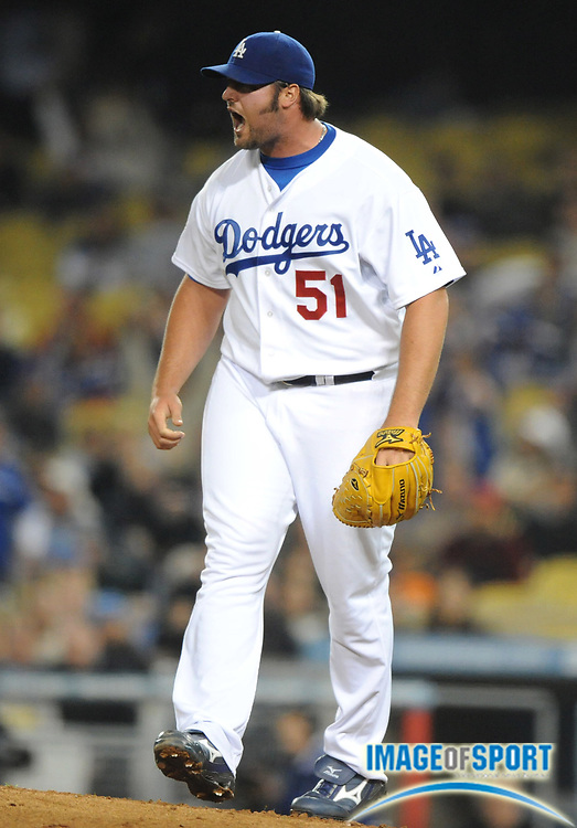 May 6, 2008; Los Angeles, CA, USA; Los Angeles Dodgers reliever Jonathan Broxton (51) celebrates after a strikeout to the end the eigth inning of 5-4 victory over the New York Mets at Dodger Stadium.